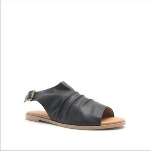 Ladies peep toe ankle buckle flat sandals. Black